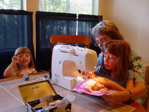 Emma sews with Grandma